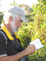 birdwatcher taking notes