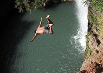 waterfall jumping: diving into the pool of the waterfalls near san blas